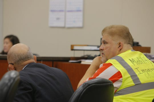 John Fickas listens at his preliminary hearing Friday, where a judge ordered him to stand trial on rape and sex crime charges.