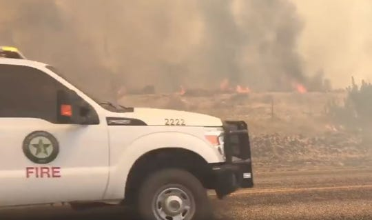 Texas Forest Service personnel and volunteer firefighters are battling a blaze along the Arden Road, which has been blocked from US 67 to County Road 411.