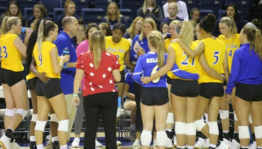 Head coach Chuck Waddington and the Angelo State University volleyball team talk things over during a match against Southeastern Oklahoma at the Kathleen Brasfield ASU Invitational Friday, Sept. 6, 2019.