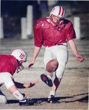 Christoval High School's Dusty Barton (10) holds the ball for placekicker Thomas Packness during practice Dec. 11, 1990, for the 1990 six-man state championship game.