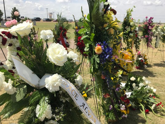 More than 30 flower arrangements line one side of the burial service for Leilah Eliana Hernandez, a 15-year-old victim of a mass shooting in Midland Odessa. September 6, 2019.