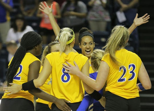 The Angelo State University volleyball team celebrates during a match against Southeastern Oklahoma at the Kathleen Brasfield ASU Invitational Friday, Sept. 6, 2019. The Rambelles won 25-7, 25-11, 20-25, 25-10.