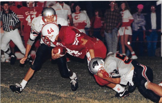 Christoval High School's Randy Robertson (44) carries the ball for a gain against Panther Creek during a game in Christoval Oct. 12, 1990.