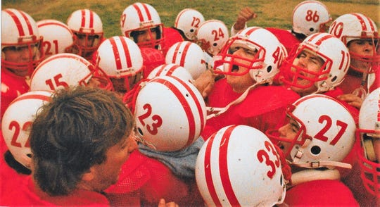 Christoval football coach Billy Barnett (foreground) speaks to the Christoval Cougars during practice for the 1988 season.
