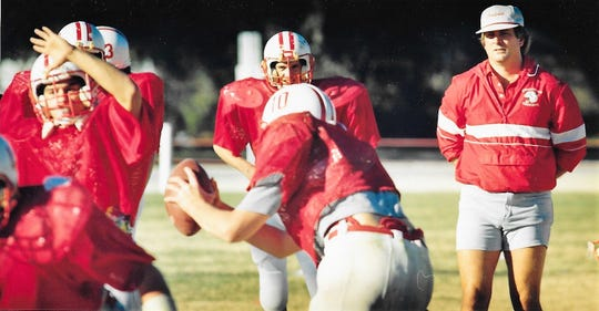 Head football coach Billy Barnett watches his Christoval Cougar team practice in preparation for a playoff game against Fort Hancock in 1989.