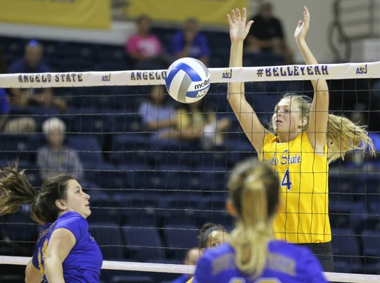 Angelo State University's Sophia Berg blocks a shot during a match against Southeastern Oklahoma at the Kathleen Brasfield ASU Invitational Friday, Sept. 6, 2019. The Rambelles won 25-7, 25-11, 20-25, 25-10.