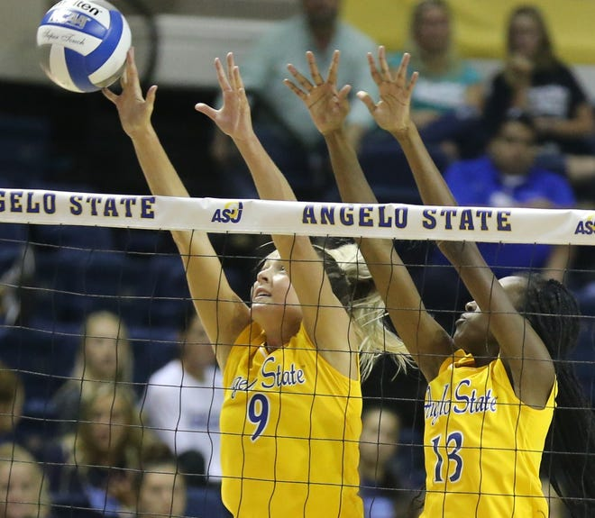 Angelo State University's Kailyn Gilbreath (left) and Grace White jump up for a block during a match against Southeastern Oklahoma at the Kathleen Brasfield ASU Invitational Friday, Sept. 6, 2019.