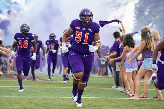 Nathalohn Nanai leads the Demons through the Inferno prior to the 2018 home opener vs. Grambling.