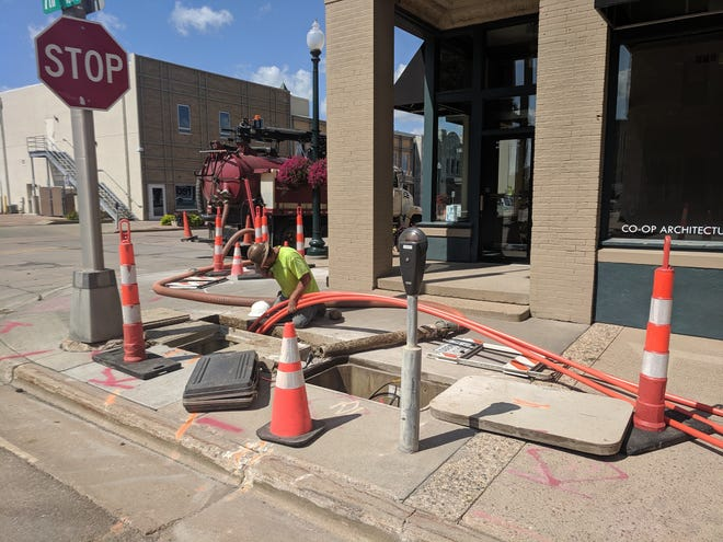 Contractors working for SDN Communications spent the last two weeks installing the necessary fiber optic lines downtown that will feed Verizon Wireless's 10 small cell towers going up in the core of Sioux Falls.