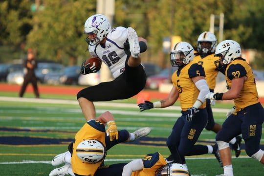 USF's Clint Sigg leaps over the Concordia defense in Thursday's loss to the Bears.