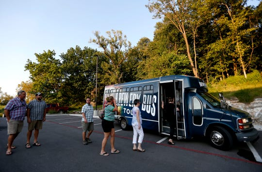 Guests board a bus from 417 Brewery Bus Tours at Great Escape Beer Works on Thursday, Sept. 5, 2019.