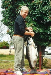 Otwin Kandolf holds the current world record brown trout he caught in New Zealand in 2013.  It weighed 42 pounds, 1 ounce.