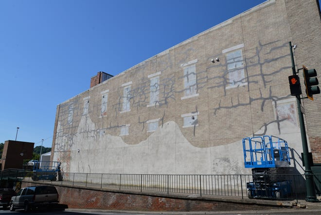 Prepping for a new mural on the side of 102 W. Beverley St. in downtown Staunton.  A new mural will be painted thanks to a Virginia Tourism Corporation grant.