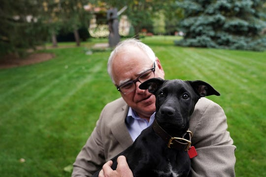 Gov. Tim Walz holds Scout, a 3-month-old Labrador Retriever that the Walz family adopted, during a news conference to announce the family's newest addition at the governor's residence Thursday, Sept. 5, 2019. (Anthony Souffle/Star Tribune via AP)