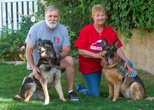 Jim and Linda Crismer, who adopted two veteran military canines Mazzie and Geli from Kuwait, are photographed Wednesday, Aug. 28, 2019. The dogs were rescued part of an effort to save dogs abandoned by the U.S. military after their handlers return home from duty. (Rick Egan /The Salt Lake Tribune via AP)