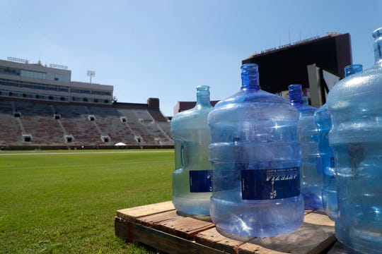 Empty water jugs sit on a palette on the Bobby Bowden Field. FSU prepares to keep the players and fans cool after many complaints of heat-related illnesses from last week's game.