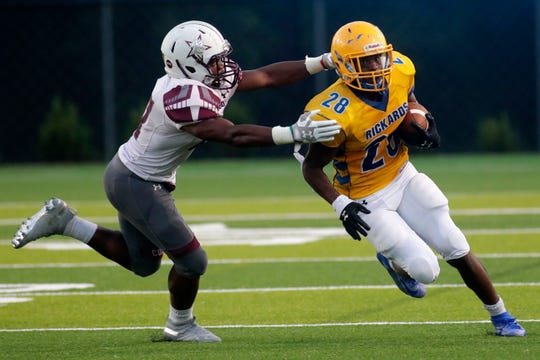 Rickards running back Devin Bailey (28) makes a break for it down the field during a 28-6 loss to Madison County last week.