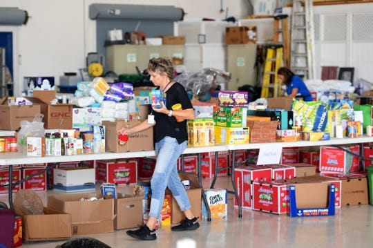 Missionary Flights International continued receiving, sorting and packing donations from the public to help aid the people of the Bahamas on Friday, Sept. 6, 2019 after Hurricane Dorian swept over the island chain.