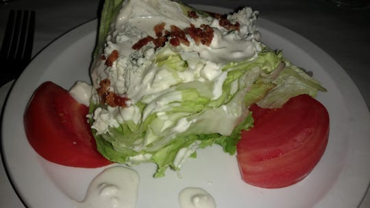 A cold, crisp, refreshing wedge salad with tangy blue cheese and bacon and slices of fresh sweet tomato make a delicious first course at Vero Prime, which recently relocated to downtown Vero Beach.