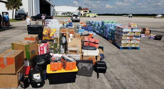 Everything from chain saws to MREs (meals ready to eat), Gatorade and baby wipes stands ready Friday on the tarmac at Stuart Jet Center to load onto aircraft bound for the northern Bahamas.