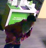 A surveillance photo of a man wanted in connection with a robbery of a Cricket Wireless store in Socorro.