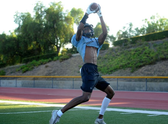 Reece Smith snares a pass during Moorpark College's practice Thursday. The Oak Park High graduate will play in his first collegiate game when the Raiders open their season Saturday at Palomar College.