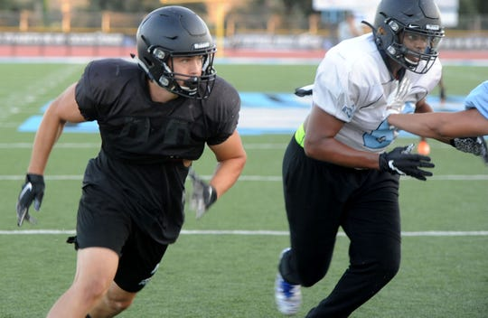 Linebacker Daniel Henderson, left, a Royal High graduate, and defensive end Ivory Jackson are two of the top defensive players for the Moorpark College football team.