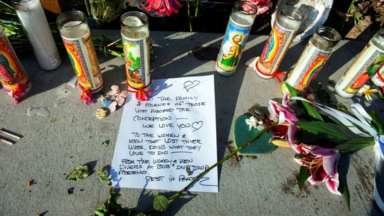 A handwritten message from members of the diving community is displayed at a memorial for the victims of Monday's dive boat fire at the Santa Barbara Harbor on Wednesday, Sept. 4, 2019, in Santa Barbara.