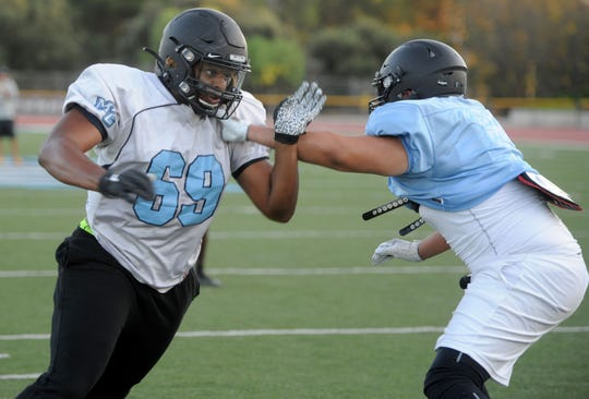 Defensive end Ivory Jackson, left, works against a teammate during Moorpark College's practice Thursday. Jackson had 11 sacks last season for the Raiders, who open the 2019 season at Palomar College on Saturday night.