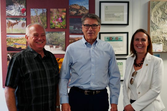 Simi Valley Mayor Keith Mashburn, left, poses with U.S. Energy Secretary Rick Perry and Simi Valley Deputy City Manager Samantha Argabrite during Perry's tour Friday of his department's portion of the contaminated Santa Susana Field Lab outside Simi Valley.