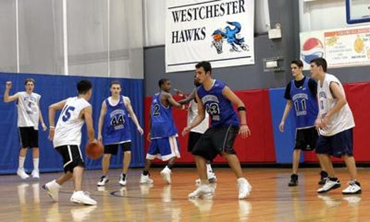 A Westchester Hawks AAU basketball team plays at the Brewster Sports Center on June 21, 2005.