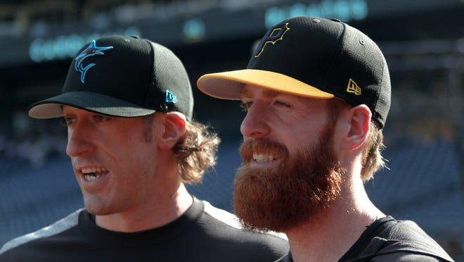 Pittsburgh Pirates' Colin Moran, right, stands with his brother Brian Moran, a pitcher for the Miami Marlins, before their teams play against each other in a baseball game, Wednesday, Sept. 4, 2019, in Pittsburgh.