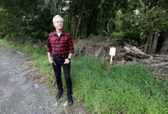 Paul E. Olsen, a paleontologist, stands near property along Route 303 in Blauvelt, Sept. 6, 2019.  He found dinosaur tracks in the area, near the area  of a proposed development.