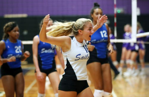 Hen Hud's Callie Pidoriano (16) celebrates after winning a set against John Jay during volleyball action at John Jay High School in Cross River Sept. 5, 2019.  Hen Hud defeated John Jay.