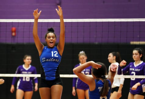 Hen Hud's Caitlin Weimer (12) celebrates a point against John Jay during volleyball action at John Jay High School in Cross River Sept. 5, 2019.  Hen Hud went on to defeat John Jay.