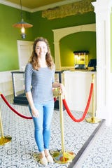 Kate Clark, manager of The Texas Theater in Saint Jo, Texas, welcomes visitors to the renovated 1879 structure given new life.