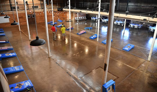 Organizers of the Bags for Brags Cornhole Tournament work out details Friday morning at The Warehouse. The event raises money for the Childrens Aid Society and Leadership Wichita Falls.