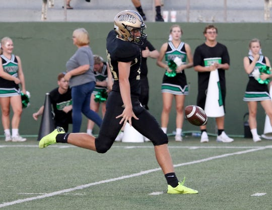 Rider's Colsen Welch punts in the game against Azle Thursday, Sept. 5, 2019, at Memorial Stadium.