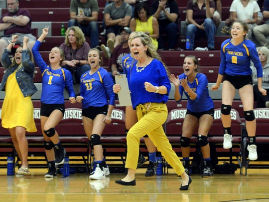 Maysville celebrates a point during the fourth set against John Glenn on Thursday night in New Concord.