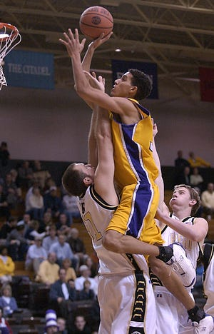 Western Carolina's Kevin Martin, a Zanesville native, goes up in the lane during a March 2004 game against Wofford. Martin will be inducted into the Catamounts' Athletic Hall of Fame in November.