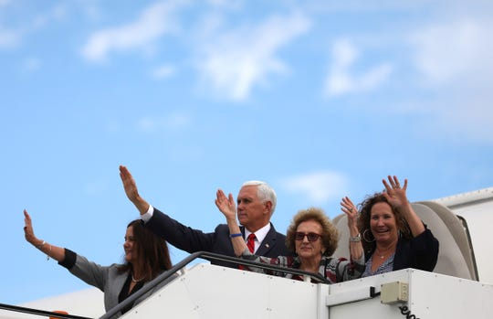 Vice President Mike Pence and members of his family, his wife Karen Pence, left, mother Nancy Pence-Fritsch, and sister Ann Poynter, right, wave goodbye as they board Air Force Two at Dublin airport Ireland, Tuesday, Sept. 3, 2019.