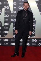 Musician Sam Smith rocked the GQ Men of the year Awards red carpet in London on Tuesday in a black tux and high-heeled patent leather boots.