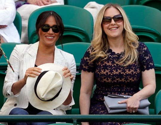 Duchess Meghan of Sussex and a friend watch Serena Williams play at Wimbledon on July 4.