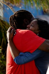 Nassau resident Sandra Ferguson, 55, embraces her brother, Dereck Bain, 46, in Marsh Harbour on Abaco in the Bahamas after a nerve-wracking trip to the disaster left behind by Hurricane Dorian. Ferguson couldn't reach her brother via cell phone and flew to the island in hopes she could find him.