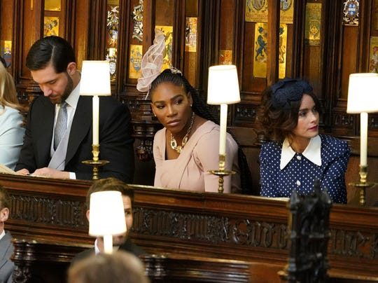 Alexis Ohanian (l) and his wife, Serena Williams, seated prior to the start of the wedding ceremony of Prince Harry and Meghan Markle at St. George's Chapel at Windsor Castle, May 19, 2018.