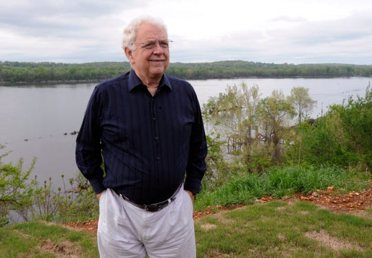 """FILE - In this Tuesday, April 14, 2015 file photo, Jimmy Johnson, sound engineer for the Percy Sledge's hit """"When a Man Loves a Woman,"""" stands outside his Tennessee River home in Sheffield, Ala. Jimmy Johnson, a founder of the Muscle Shoals Sound Studios and a guitarist with the famed studio  musicians nicknamed """"The Swampers"""" has died. He was 76. His family announced his death in a Facebook post, Thursday, Sept. 5, 2019.  (AP Photo/Jay Reeves, File) ORG XMIT: NY116"""