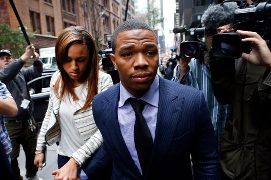 Ray Rice, left, arrives with his wife Janay Palmer for an appeal hearing of his indefinite suspension from the NFL. Rice never played in the NFL after being suspended.