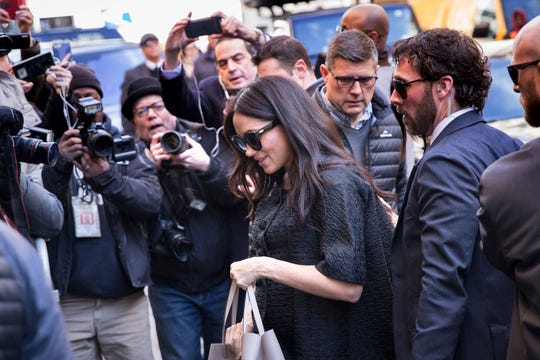 Duchess Meghan of Sussex, surrounded by media and security, arrives for her baby shower at the Mark Hotel, Feb. 19, 2019, in New York.