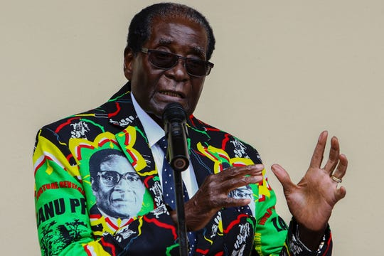 Then Zimbabwe President Robert Mugabe speaks at the party's annual conference in Masvingo on December 17, 2016.