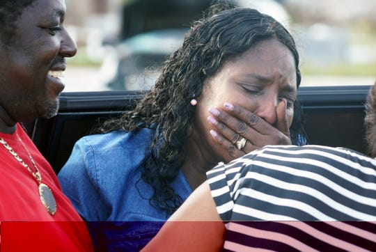 Nassau resident Sandra Ferguson, 55, cries after being reunited with her brother, Dereck Bain, 46, in Marsh Harbour on Abaco in the Bahamas after a nerve-wracking trip to the disaster left behind by Hurricane Dorian. Ferguson couldn't reach her brother via cell phone and flew to the island in hopes she could find him.